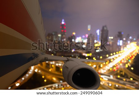 airplane taking off from shanghai in the night - stock photo