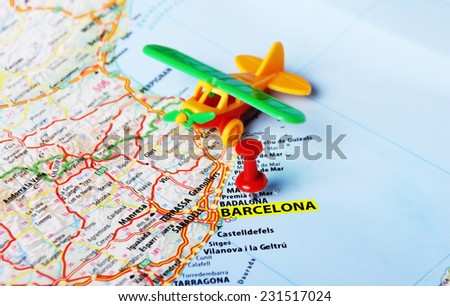 Airplane toy on  Barcelona ,Spain  map and red pin - Travel concept - stock photo