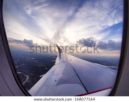 Airplane travel time is sunset - stock photo
