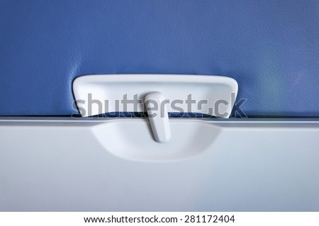 Airplane Tray Table, close-up of latch and tray - stock photo