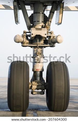 Airplane wheel close-up - stock photo