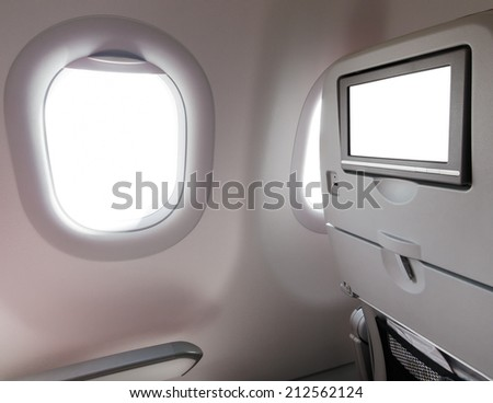 Airplane window seat with LCD screen - stock photo