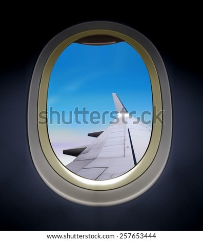 Airplane window with wing view - stock photo