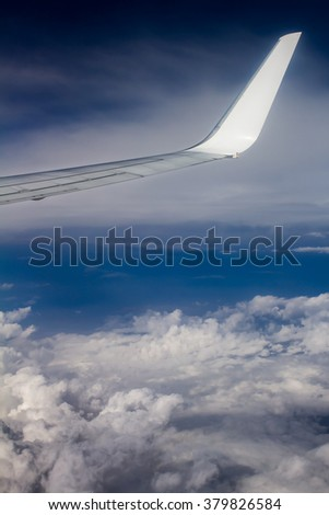 Airplane wing above the sky - stock photo