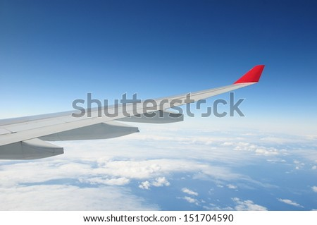 Airplane Wing - Air Travel Theme - stock photo