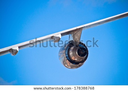 Airplane wing and turbine and a blue sky - stock photo
