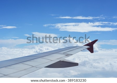 Airplane wing blue sky cloud  top view