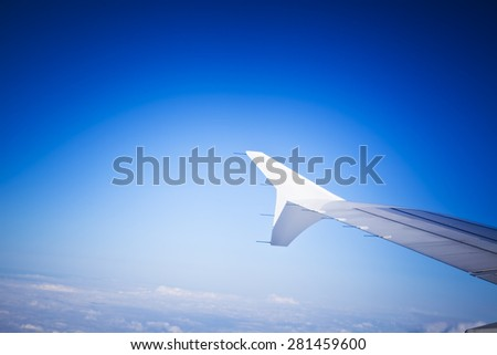 Airplane Wing in Flight, looking through window