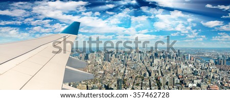 Airplane wing over New York City skyline. - stock photo