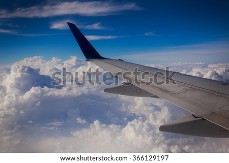 airplane wing sky clouds