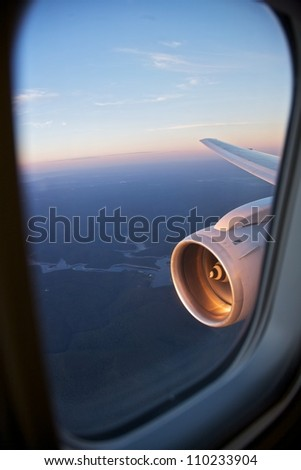 Airplane wing view - stock photo