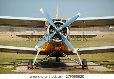 Airplane with blue propeller. Old retro plane close-up. Front view, with the side of the fuselage. - stock photo
