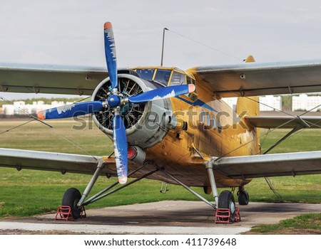 Airplane with blue propeller. Old vintage single-engined plane. Retro biplane. Selective focus. - stock photo
