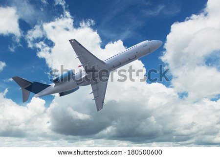Airplane with cumulus clouds