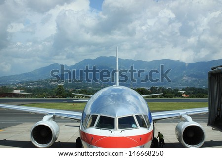 Airplane with mountains in the distance. Getting ready for takeoff. - stock photo