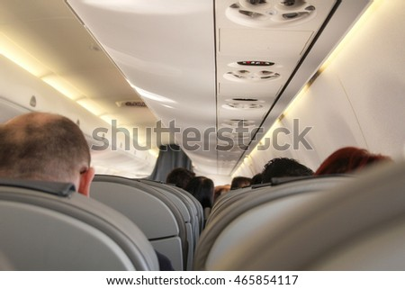 Airplane with passengers of economy class cabin