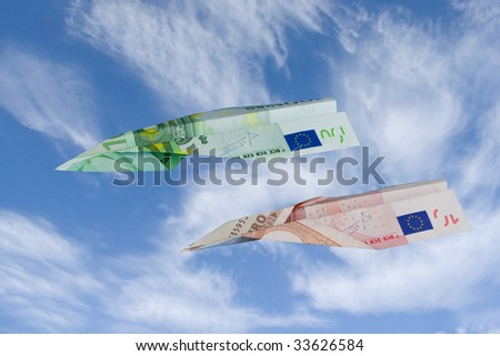Airplanes made from euro currency on sky.
