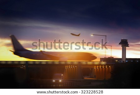 Airport airliner at dusk departure with control tower - stock photo