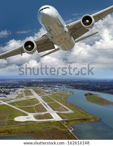 Airport and airplane above Sea Island, Vancouver International Airport and Mt. Baker on the horizon - stock photo