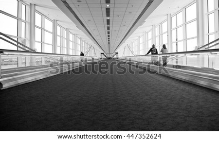 Airport Architecture Escalator Movement and Skyway Perspective - stock photo