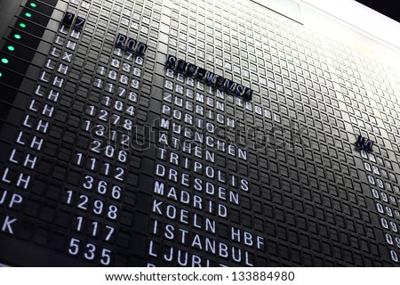 Airport arrival board. Information changing. - stock photo