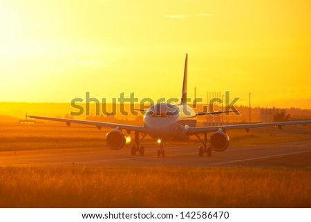 Airport at the sunset - back lit - stock photo