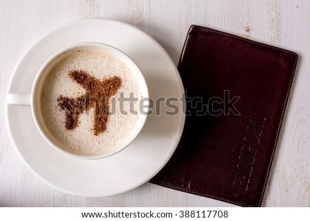 airport coffee cup. fresh cappuccino on table, view from above - stock photo