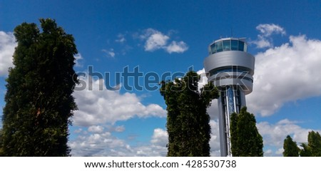 airport control tower at cloudy sky - stock photo