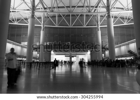 Airport departure hall scene in black and white (blurry)