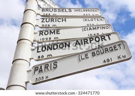 Airport destinations in Europe - old sign at Birmingham Airport, UK. Directions to Brussels, Zurich, Rome, London and Paris. - stock photo
