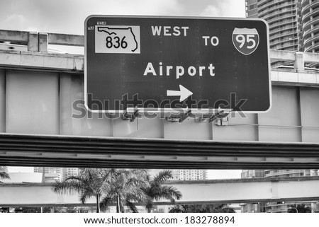 Airport directions. Interstate sign. Black and white filter - stock photo