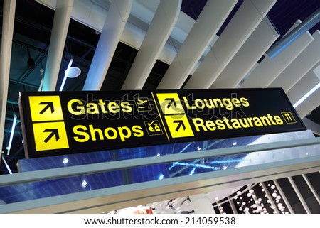 Airport flight gate, shop, restaurant and lounge direction information sign - stock photo