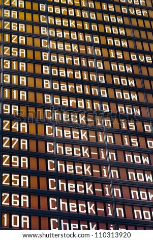 Airport flight schedule with the list of flights and information on registration - stock photo