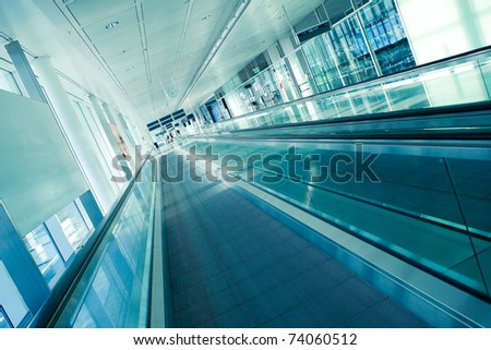 airport interior with moving stairway, picture taken at Munich Airport