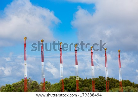 Airport lights for aircraft landing on blue sky - stock photo