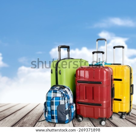 Airport. Luggage consisting of large suitcases rucksacks and travel bag isolated on white - stock photo