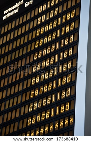 airport panel showing cancelled flights  - stock photo
