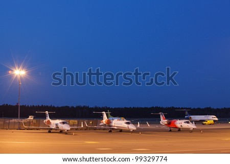 airport parking area with private jets - stock photo