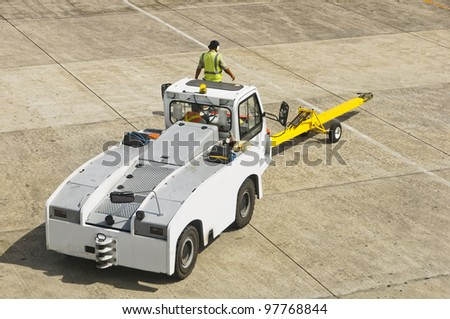 Airport personnel ground support on tarmac in their truck - stock photo