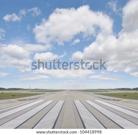Airport Runway Beautiful Blue Sky with Clouds - stock photo
