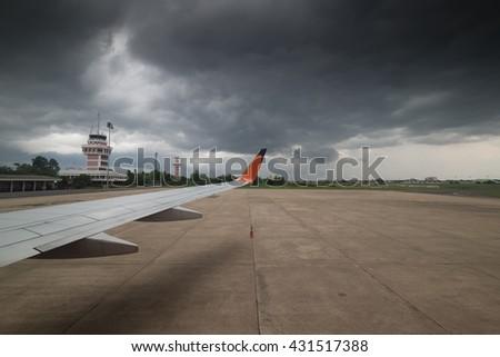 Airport runway in bad weather. - stock photo