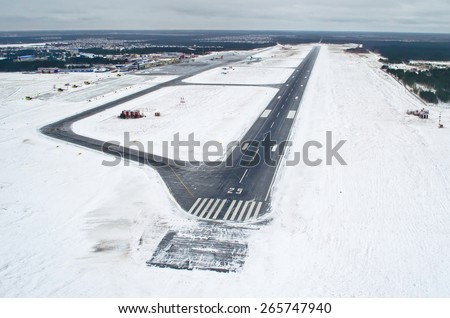 Airport Runway takeoff airplane flight travel sky clouds snow winter Siberia - stock photo