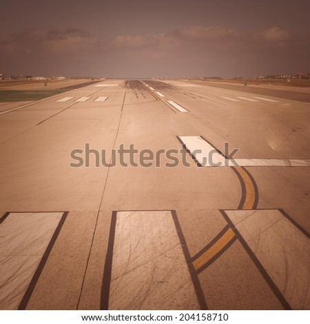Airport Runway with retro Instagram style processing - stock photo