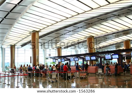 Airport scenes background series. Terminal two, Changi Airport Singapore. Travellers waiting to check-in. - stock photo
