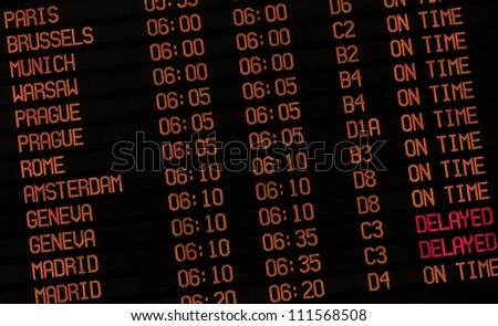 Airport Schedule board  showing  flight status and gate numbers - stock photo