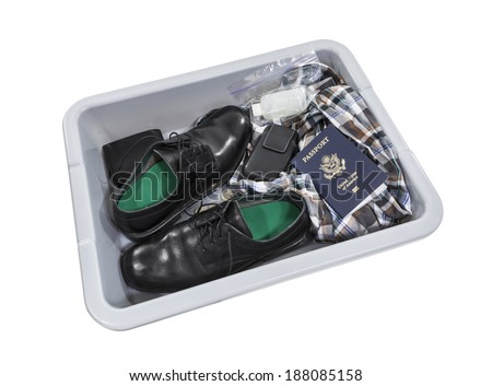 Airport screening security tray isolated with clipping path. - stock photo