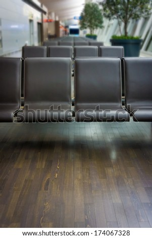 Airport seats for passengers in an airport - stock photo