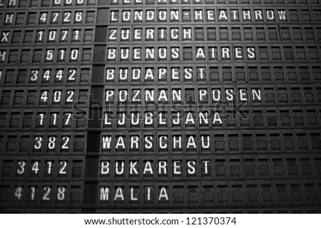 Airport sign of flights and departure times - stock photo