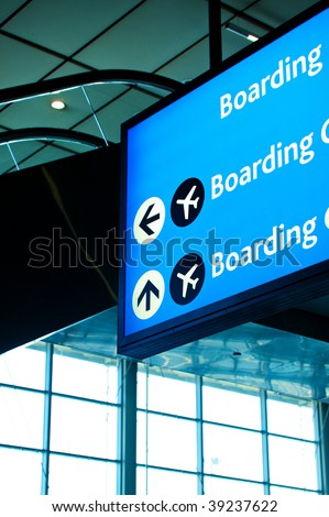 Airport signage directing to boarding gates