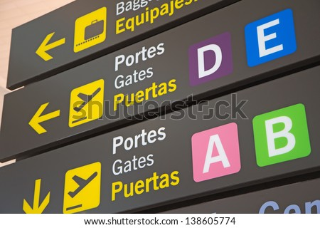 Airport Signs in English and Spanish language. - stock photo